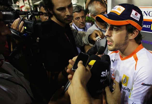 Fernando Alonso faces a sceptical media in Singapore ahead of tomorrow's Grand Prix