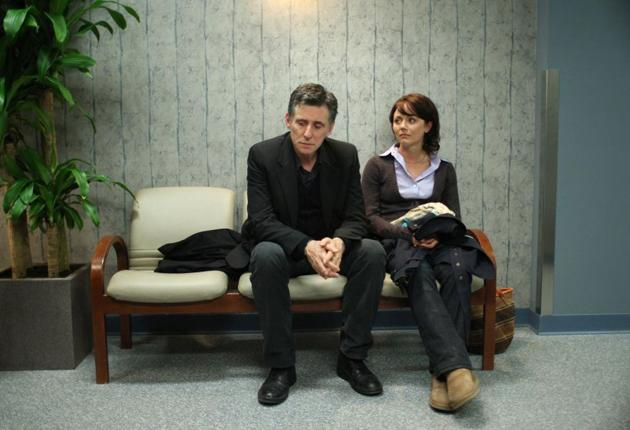 Gabriel Byrne with Lauren Hodges, plays a psychotherapist whose clients' sessions take up each episode.