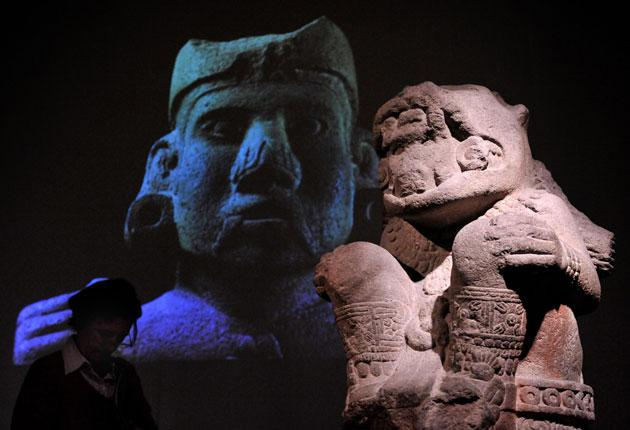 Screen idol: A stone jaguar and an image of Moctezuma tower over visitors