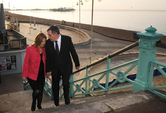 Gordon and Sarah Brown take a morning stroll along the seafront in Brighton