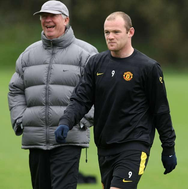 Rooney pictured during training with Sir Alex Ferguson