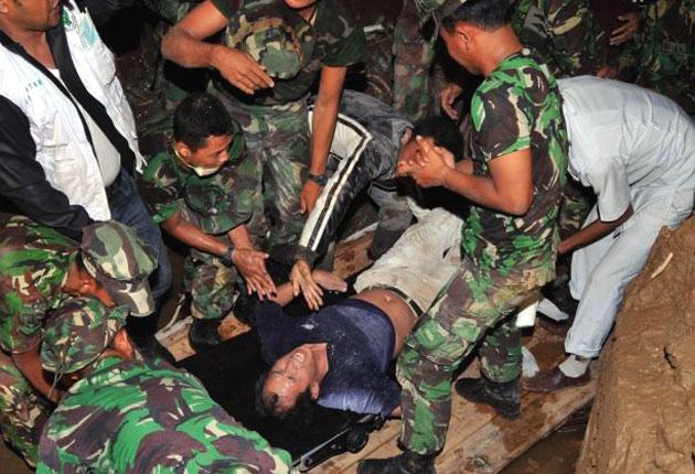 A man from Singapore is pulled alive from the rubble of the Maryani hotel