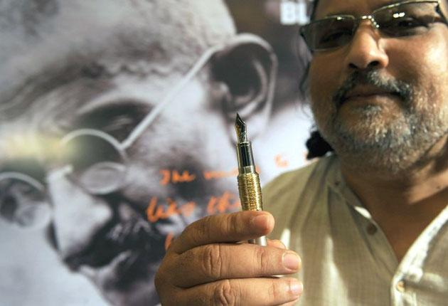 Tushar Gandhi, with the £14,000 Montblanc pen, says his great grandfather Mahatma Gandhi 'would not have used such an expensive pen'