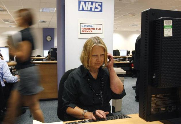 A worker at one of the 19 National Pandemic Flu Service call centres answer calls from concerned members of the public