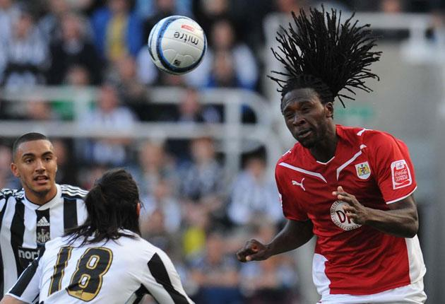 Bristol City's Evander Sno hits the heights with a headed clearance during a goalless draw at St James' Park