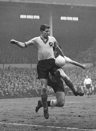 Bly, playing for Norwich City, shields the ball from a Tottenham Hotspur defender during the 1-1 draw in the FA Cup fifth round at White Hart Lane in February 1959. Norwich won the replay 1-0, eventually losing to Luton Town in the semi-finals