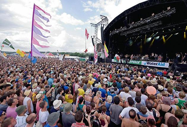 Fans fill the field as British singer Peter Doherty performs on the Other stage on the second day of the 2009 Glastonbury festival