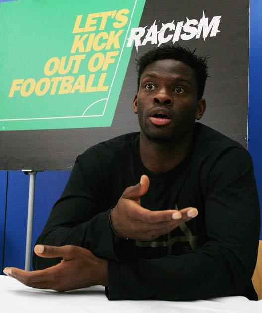 Striker Louis Saha pictured working as part of the 'let's kick racism out of football' initiative