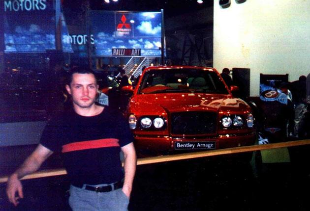 Aleksey Baranovsky, pictured at a motor show, came to Britain in 1998 to improve his English. But the exchange programme was a sham and he found himself involved with the Russian mafia