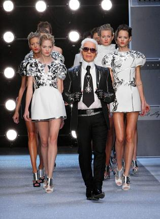 Karl Lagerfeld on the catwalk with models for his spring/summer 2010 collection at Paris Fashion Week