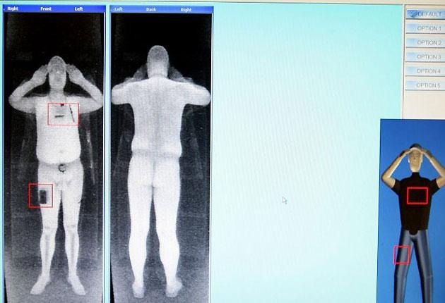 A member of staff from Manchester Airport highlights two points of threat on a scan from the new X-ray machine which is being trialled by the airport.