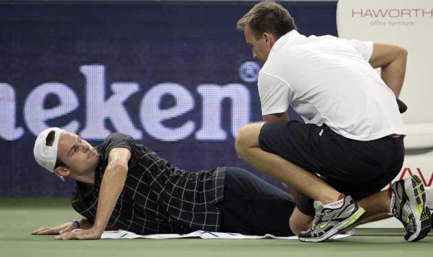 Andy Roddick receives treatment before retiring from the Shanghai Masters