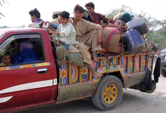 A family forced to flee the fighting yesterday in South Waziristan