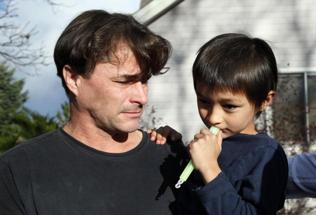 Richard Heene holding his son, Falcon, outside their house in Fort Collins, Colorado
