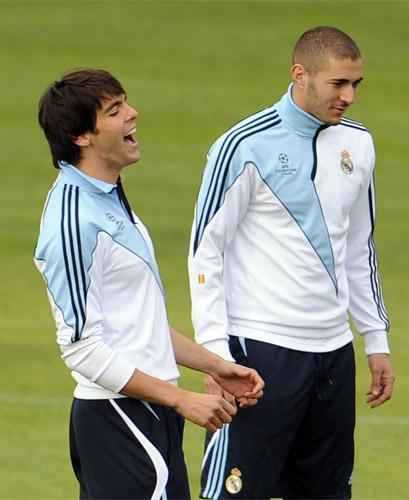Real Madrid's Kaka (left) enjoys a laugh alongside Karim Benzema during training yesterday for tonight's Champions League clash with Milan