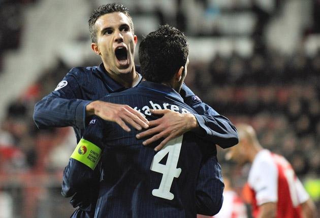 Cesc Fabregas is congratulated by Robin van Persie after putting Arsenal in the lead