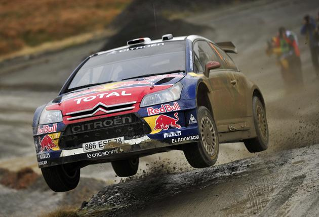 Loeb tears through the Welsh countryside outside Cardiff in his Citroën C4