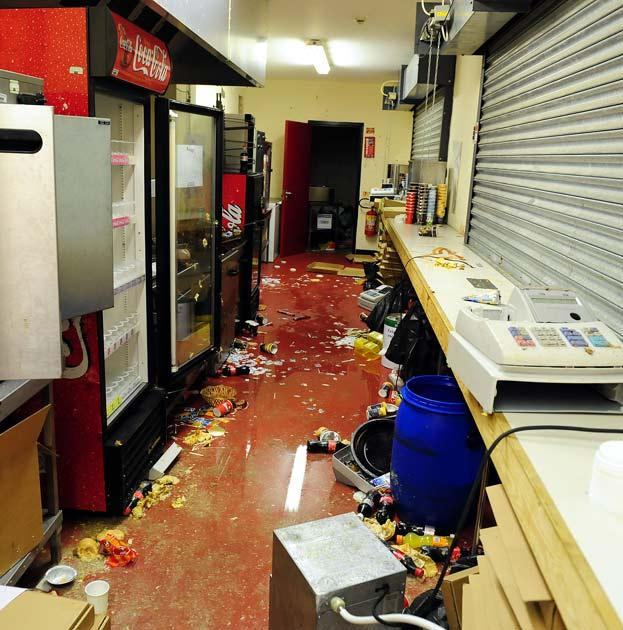 A catering outlet is destroyed and robbed of money at the away end of the ground where the Manchester United fans were housed during the Carling Cup fourth round football match against Barnsley at Oakwell