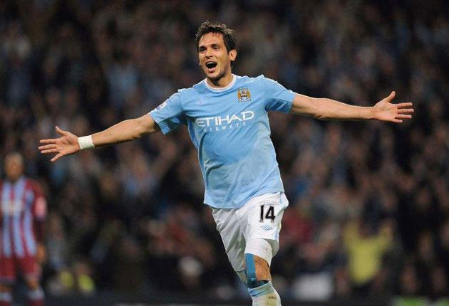 Roque Santa Cruz celebrates scoring Manchester City's second goal in their Carlin Cup rout of Scunthorpe at Eastlands last night