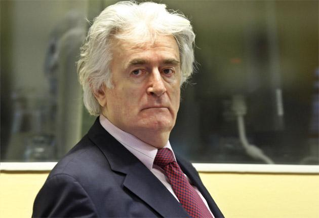 Radovan Karadzic told the war crimes tribunal yesterday that he did not want to boycott proceedings, but that his basic rights had been violated