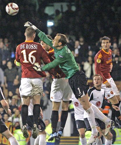 Fulham's goalkeeper Mark Schwarzer punches clear of the Roma forwards in last month's Europa Cup match between the two sides at Craven Cottage