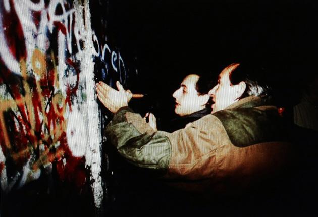 Nicolas Sarkozy's Facebook page shows him breaking down the Wall
