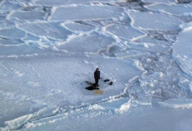 A photograph made available by Canadian Forces shows the teenage hunter trapped on an ice floe in Hudson Bay