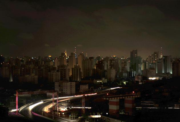 The Brazilian city of Moema on Tuesday night. Buildings were lit only by antennae and car headlights during the blackout, which affected Brazil and Paraguay