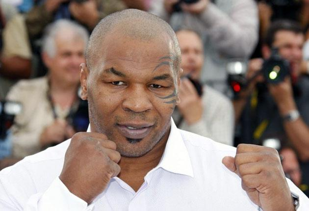 Mike Tyson and a photographer want to press charges against each other; the former heavyweight champion claims he was followed into the washrooms