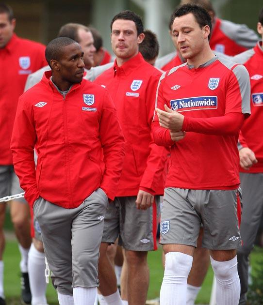 Terry pictured in training with Jermaine Defoe