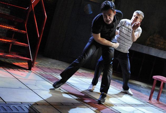 Luke Norris (left) and George Rainsford in rehearsal - Rainsford gashed his hand and damaged a tendon on the first night