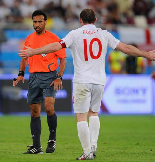 Captain Wayne Rooney still argues with the ref