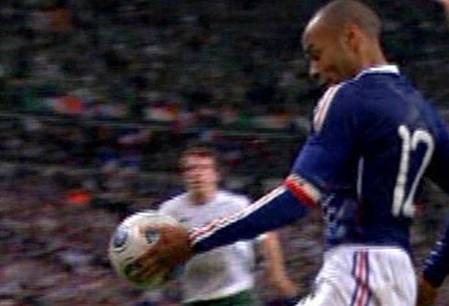 France captain Thierry Henry controls the ball with his hand during the build up to what is already being dubbed 'The Hand of Frog' goal in Paris last night