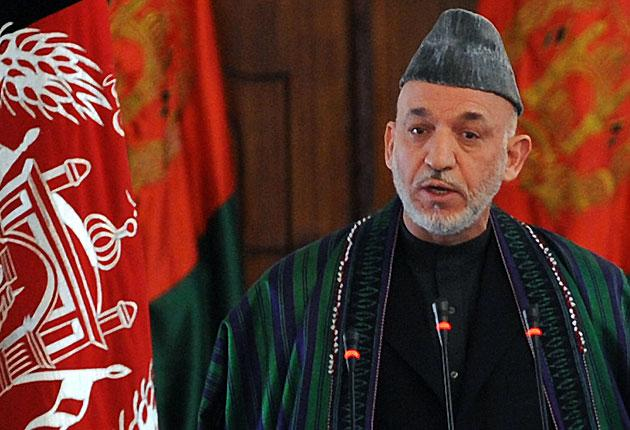Hamid Karzai delivers a speech during his swearing-in ceremony as Afghanistan's president for another five years