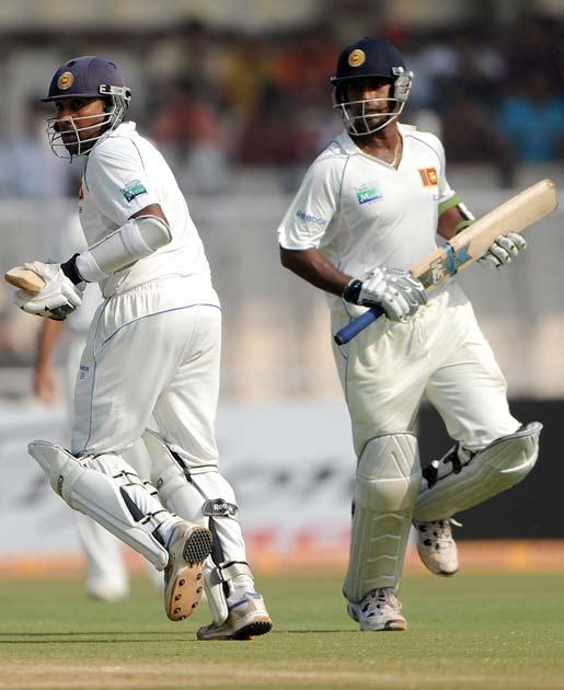 Mahela Jayawardene (L) and Prasanna Jayawardene run between wickets on the fourth day of the first cricket Test match between India and Sri Lanka