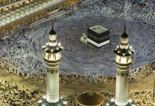 Muslims circle the Kaaba inside the Grand Mosque in the holy city of Mecca after morning prayers before this year's Haj pilgrimage