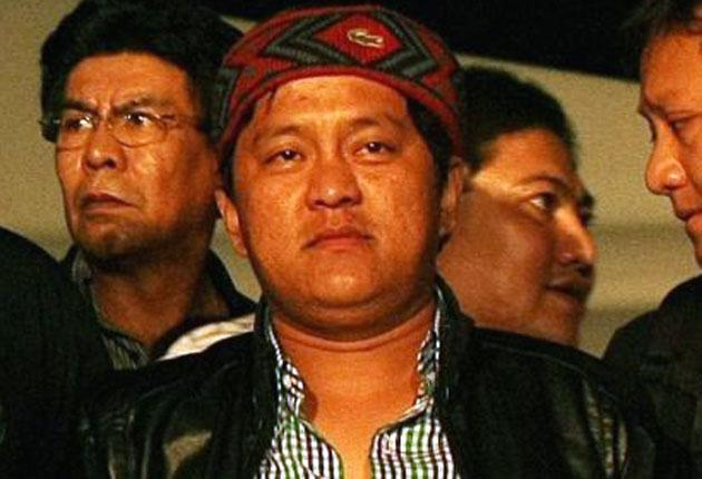 Andal Ampatuan Jr is escorted away by police after turning himself in