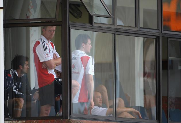 Paul Collingwood, named man of the series, cuts a bored figure with his England team-mates as the rain fell yesterday