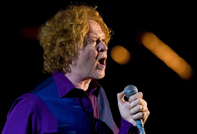 Simply Red singer Mick Hucknall is involved in a row with a neighbour over shooting and fishing rights on the Donegal estate he owns with fellow bandmember Chris de Margary