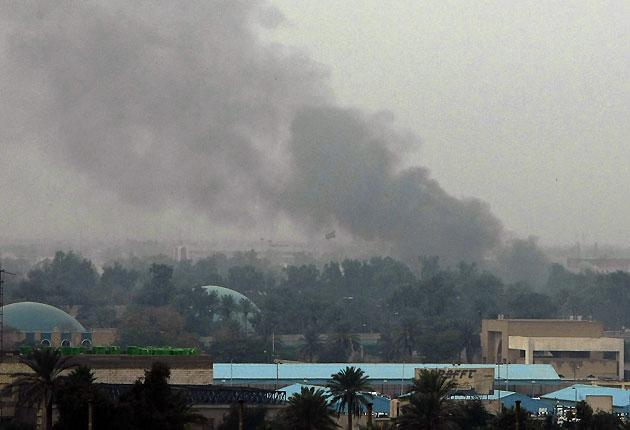 Smoke billows following an explosion in the Iraqi capital Baghdad on 8 December