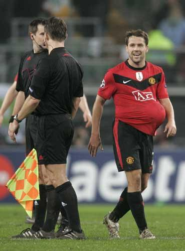 Michael Owen claims the match ball after his hat-trick in Germany last night
