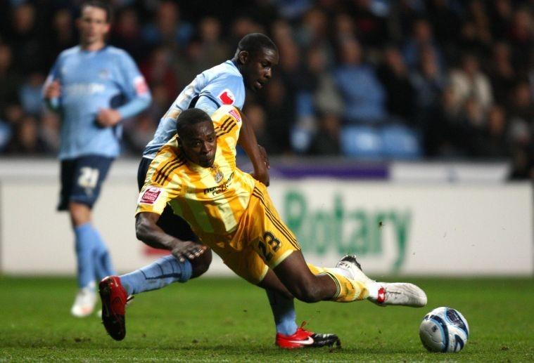 The Newcastle goalscorer Shola Ameobi is upended by Coventry's Leon Barnett at the Ricoh Arena last night
