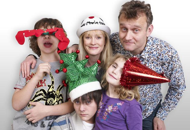 Claire Skinner, centre, and Hugh Dennis, top right, with the kids from 'Outnumbered'