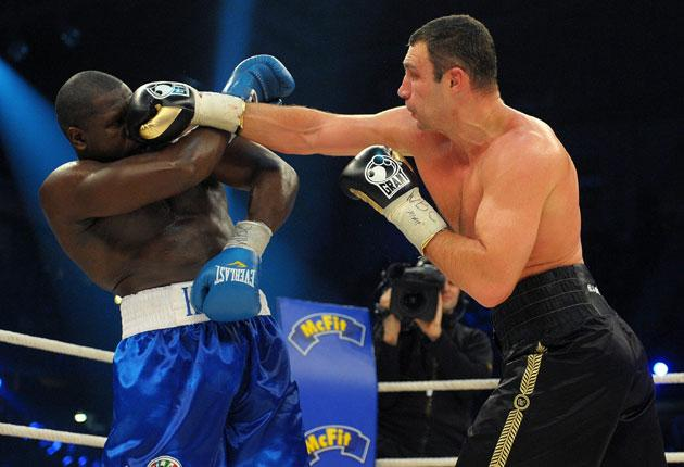 Vitali Klitschko goes on the attack against Kevin Johnson in their WBC heavyweight title fight