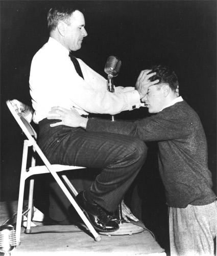 Roberts lays on hands at the Hempstead New York Crusade in 1959