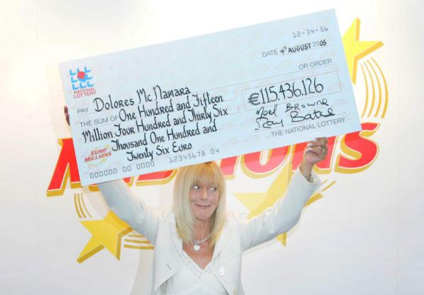 Cheque this out: A Euro Lottery millioner brandishes her winnings