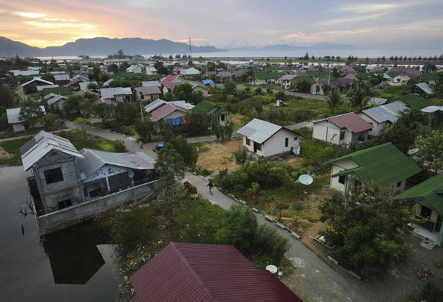 Some 140,000 new homes have been built in Banda Aceh since the 2004 tsunami, including these, constructed with British aid money, in the coastal area of Ulee Lheu