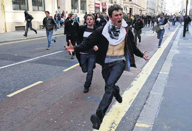 Crunch time: demonstrators charge through London during protests to coincide with the G20 summit on 1 April