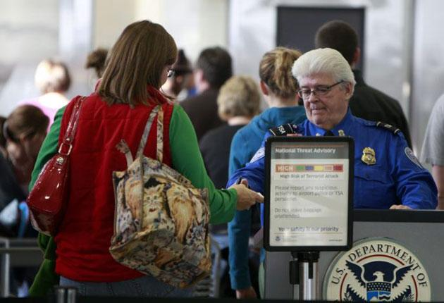 Passengers go through airport security in Detroit on Boxing Day after the foiled terror attack on Christmas Day