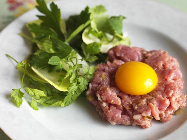 Serve rose veal tartare with a raw egg yolk for the full 'raw food' effect